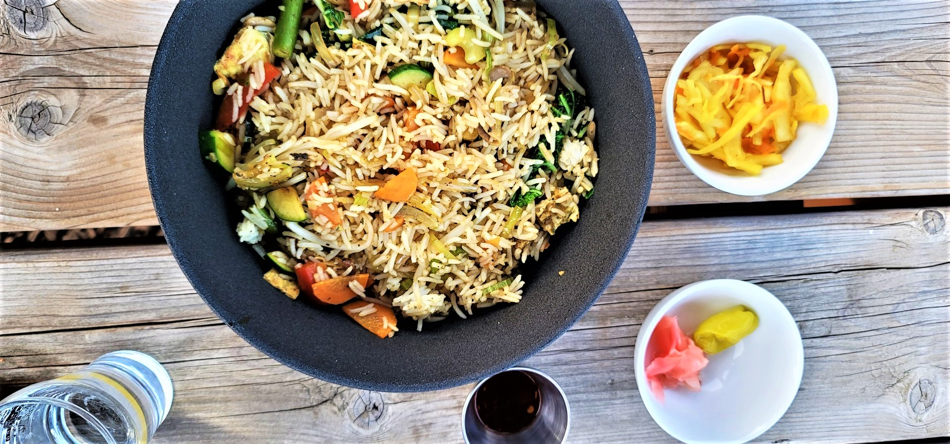 Nasi Goreng on table with condiments