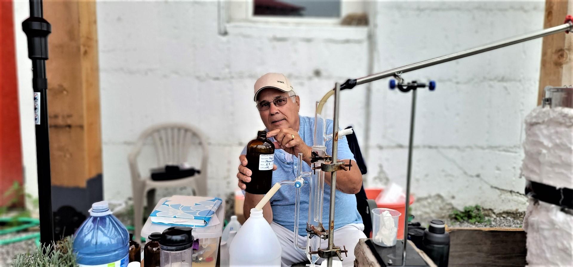 Apple Hill Lavender Farm owner showing lavender oil bottle
