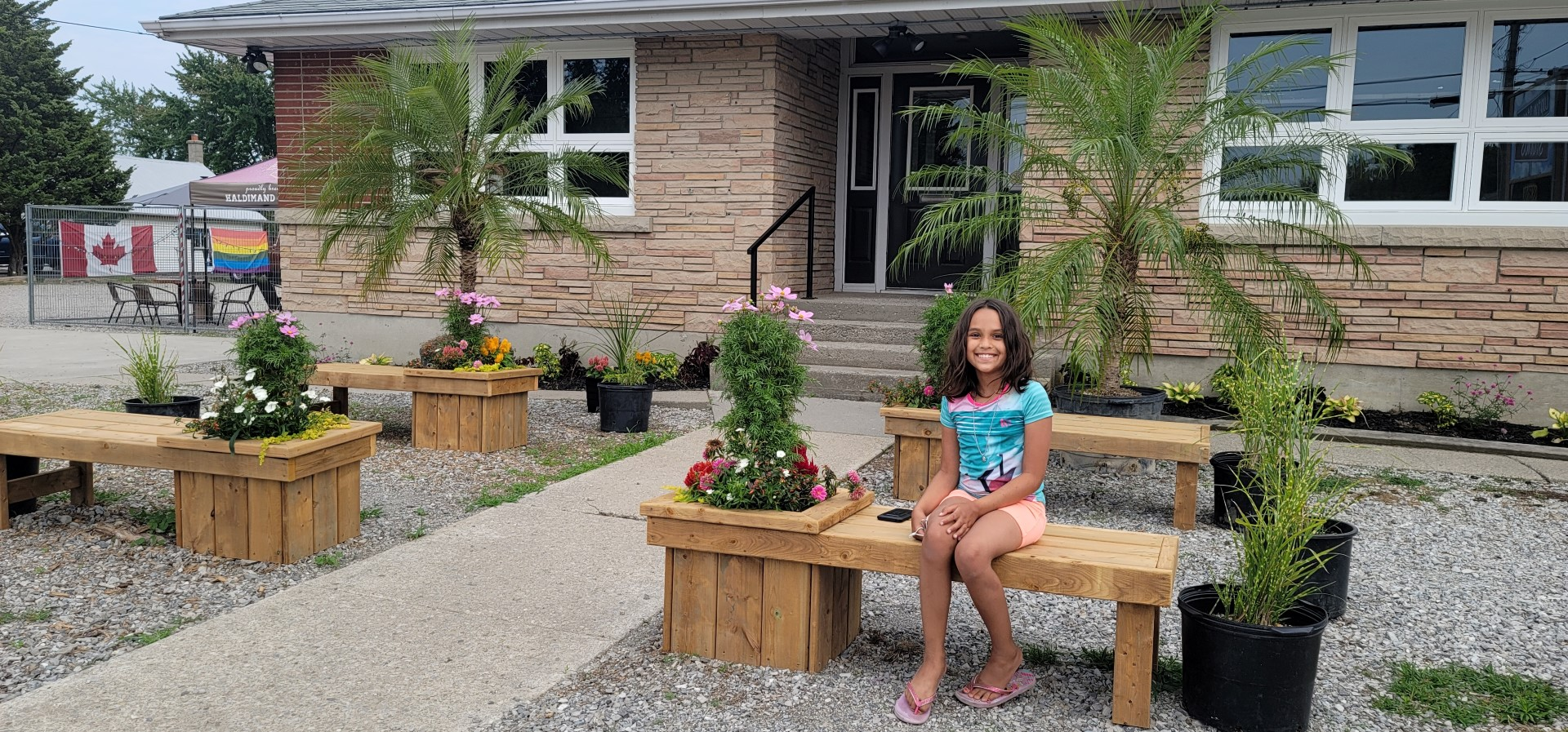 girl sitting outside Concession Road Brewery garden