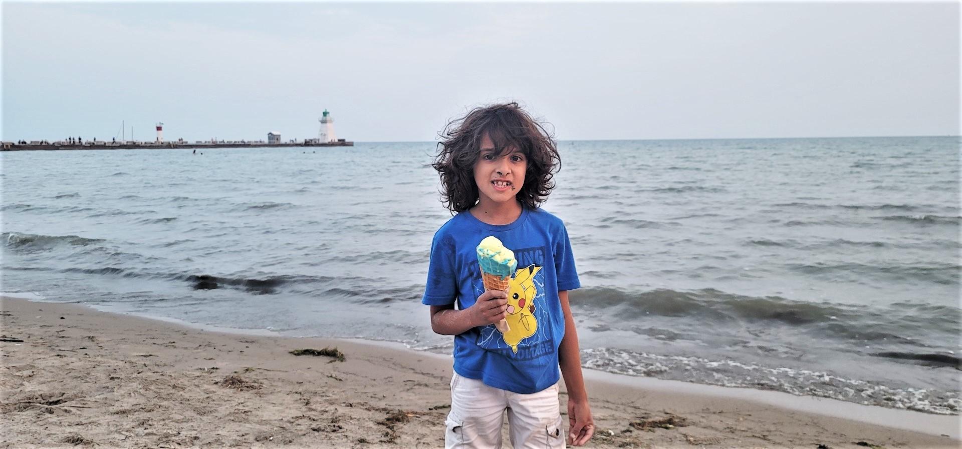 boy eating vegan ice cream in Norfolk County beach