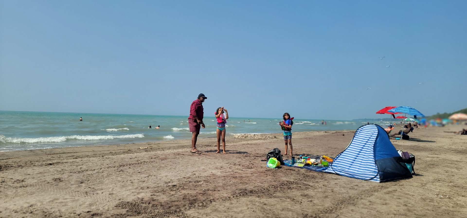 grandfather and kids at beach