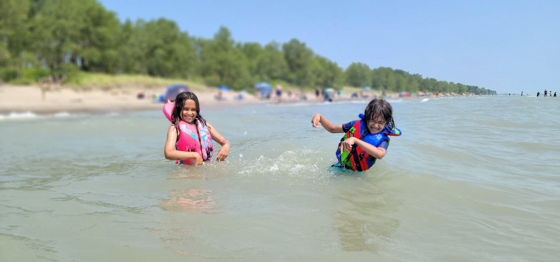 kids wearing life jackets swimming at Long Point Provincial Park