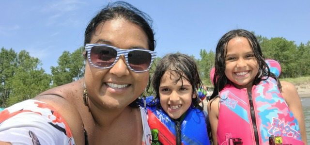 mother and kids smiling at beach