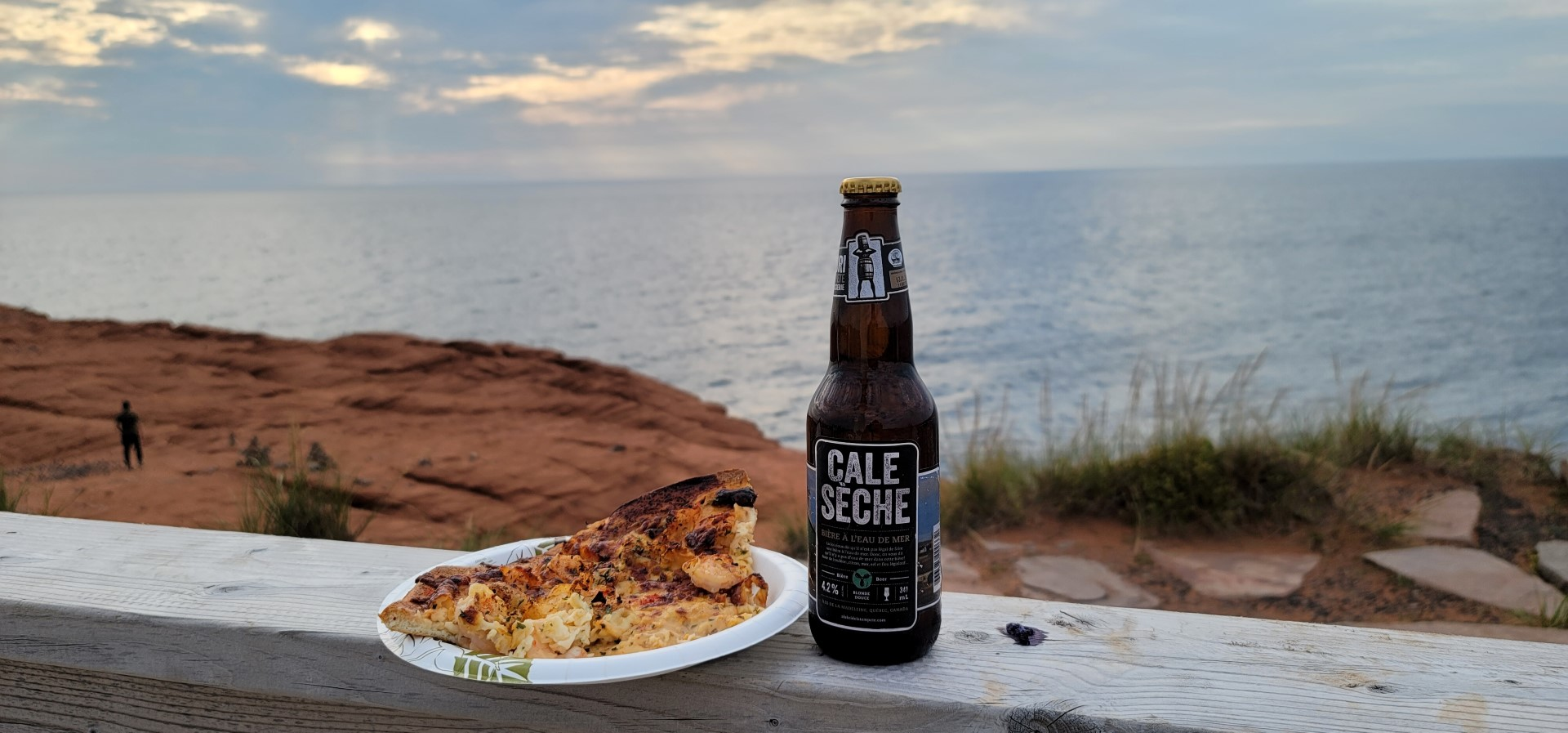 seafood pizza and a craft beer