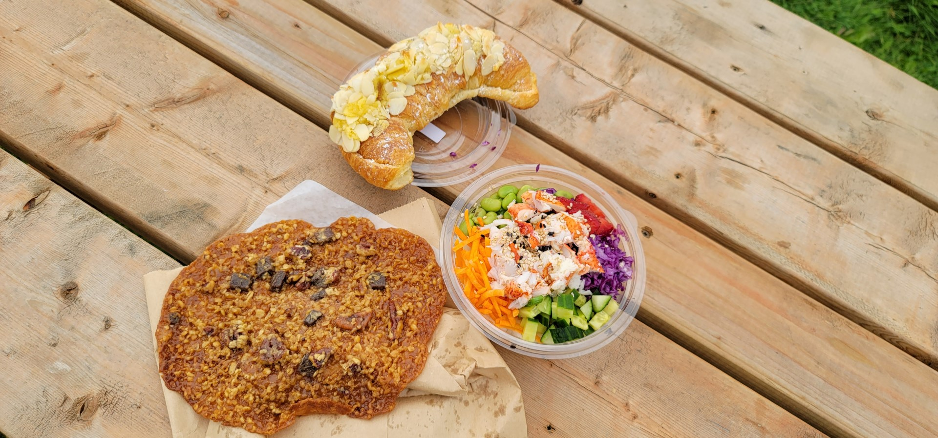 Florentine cookie, almond croissant and poke bowl on Magdalen Islands