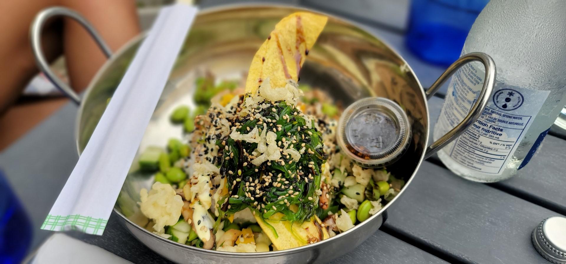 poke bowl with seaweed on top