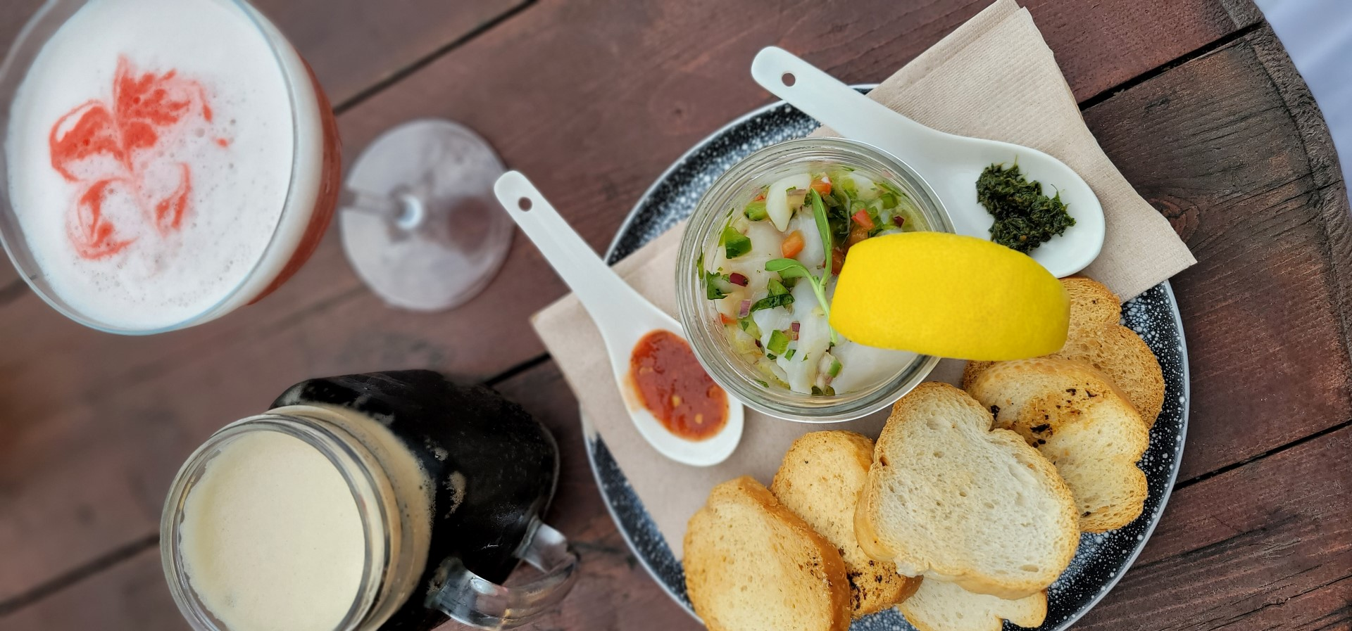 scallop tartare with spoons at la grave
