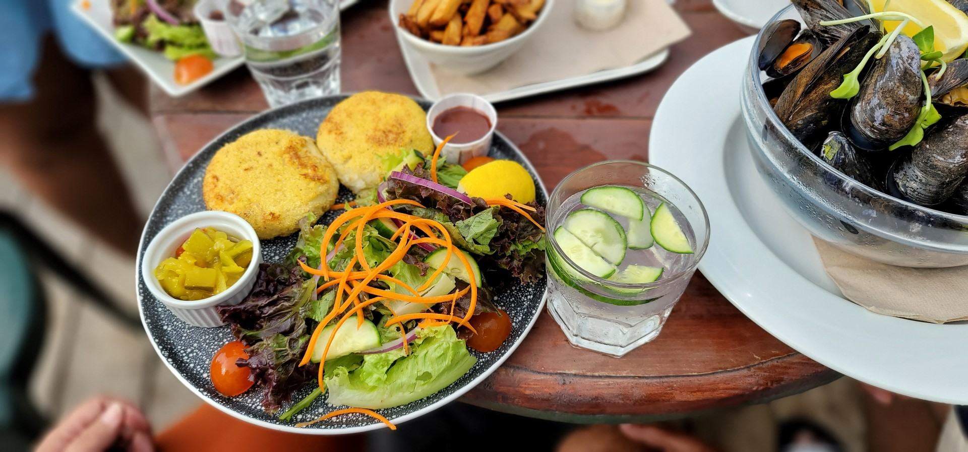 crab cakes and salad on a table