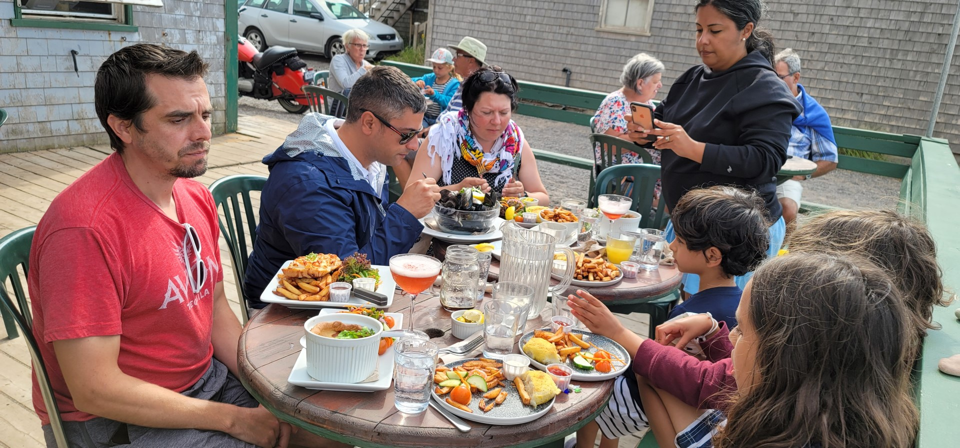 family eating on a patio in Magdalen Islands