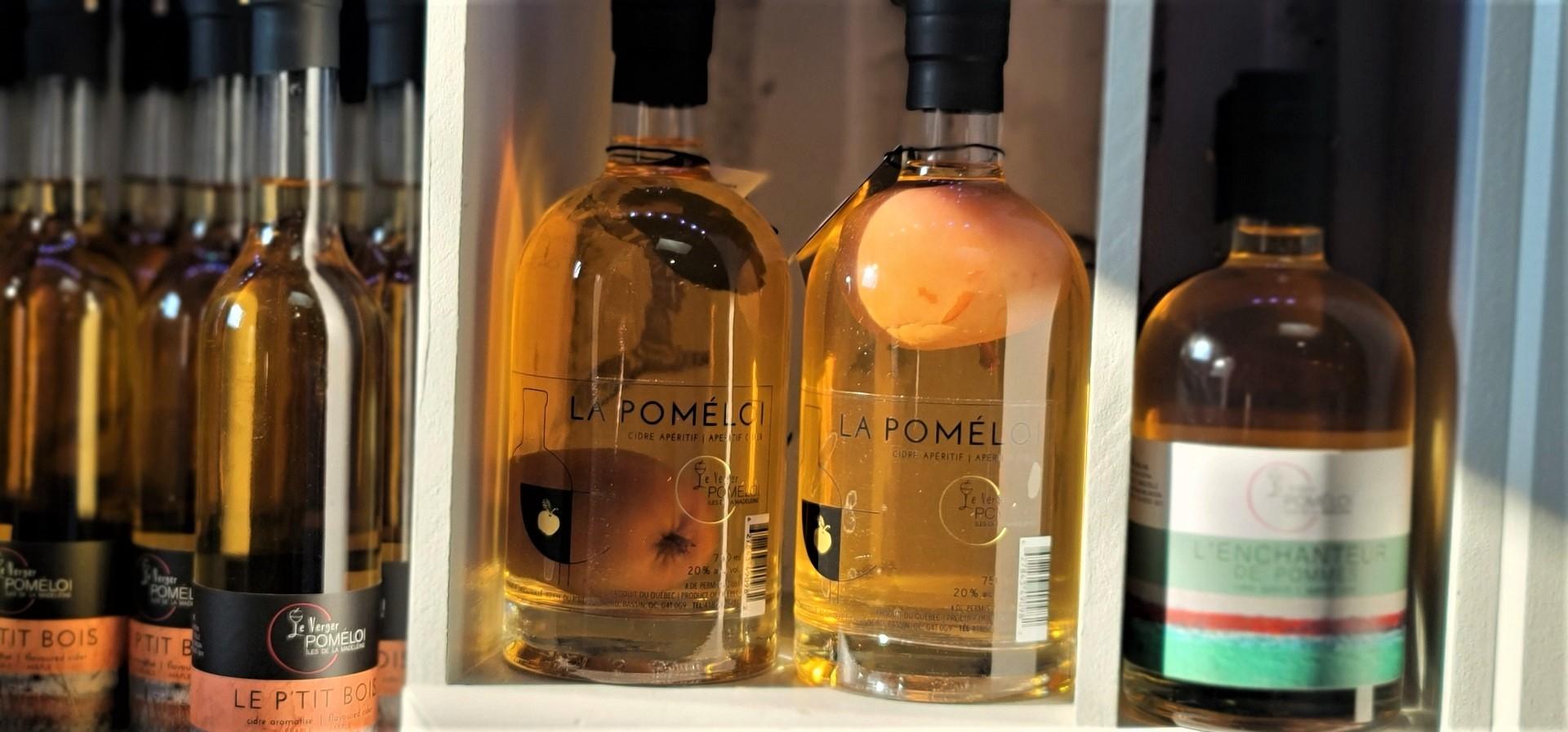 apples in bottles at Le Verger Poméloi