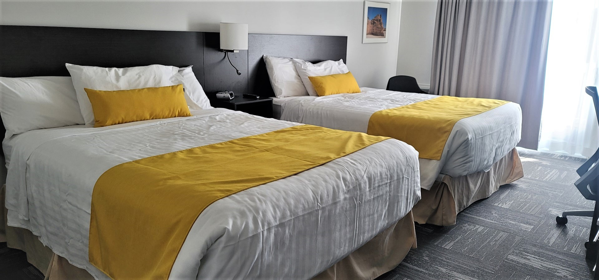white bedsheets with yellow accents at chateau madelinot