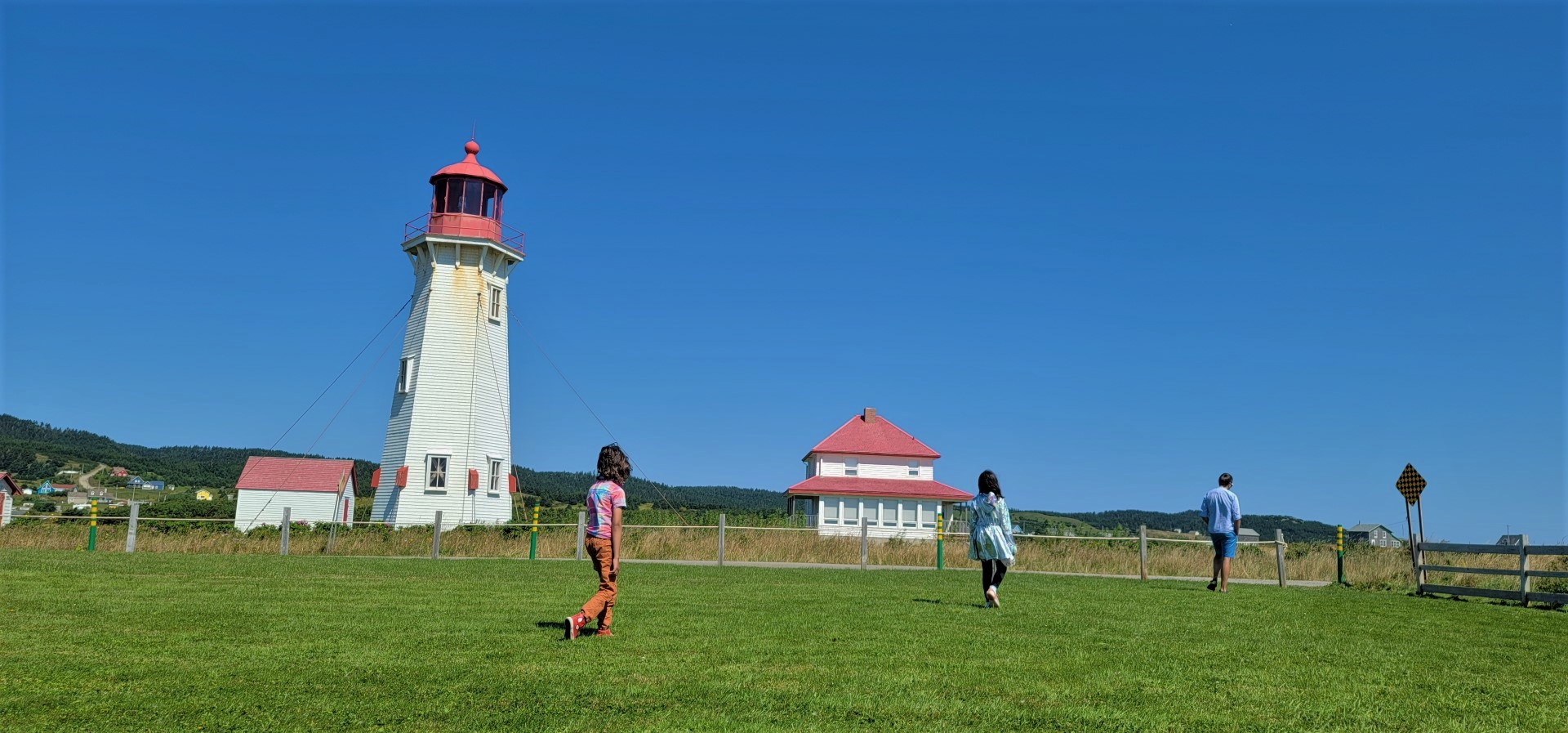 family walking in front of Magdalen Islands lighthouse
