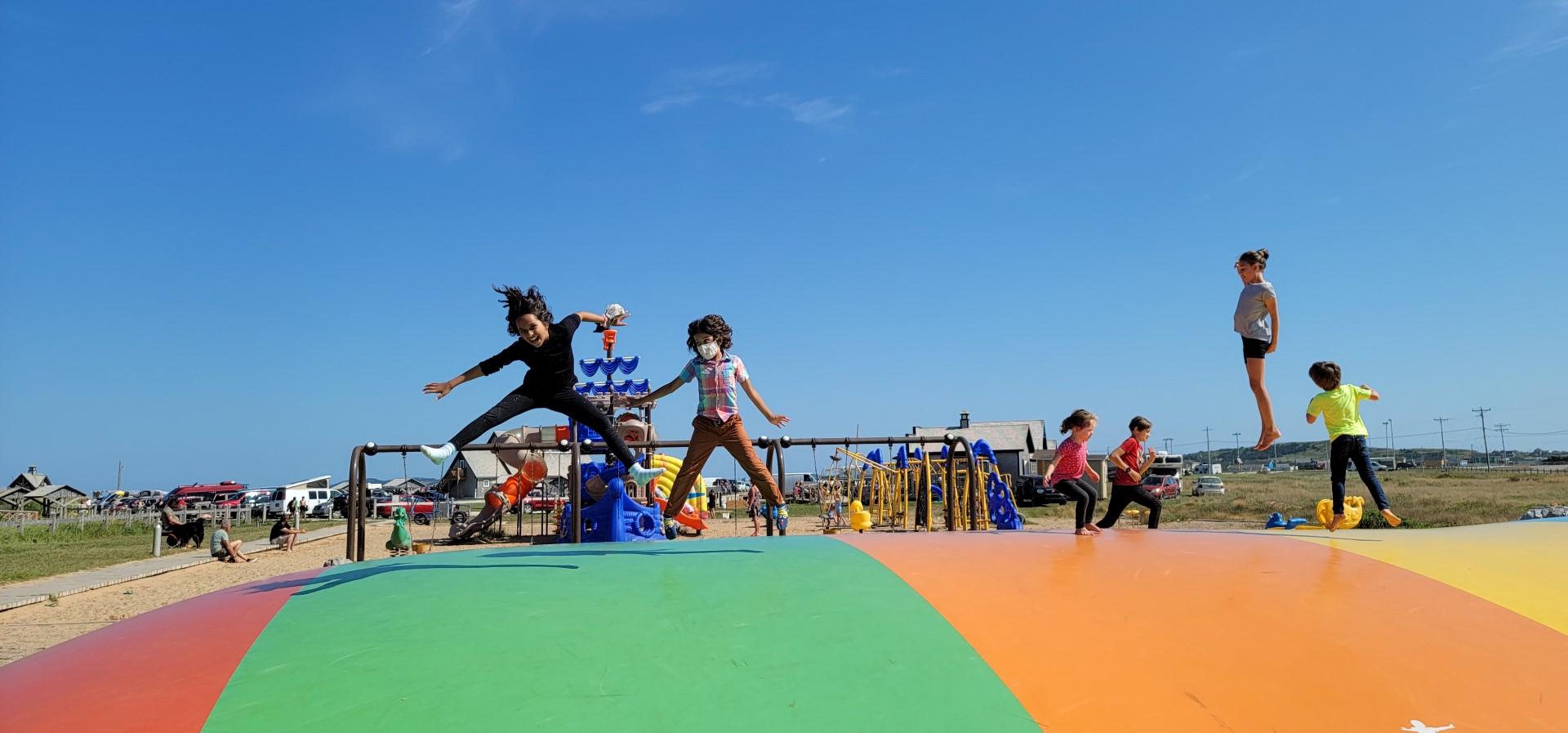 kids bouncing at L'anse-aux-Baleiniers