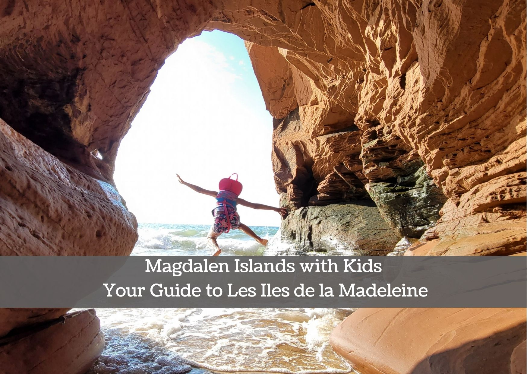 kid jumping in water and caves at Magdalen Islands Les Iles de la Madeleine