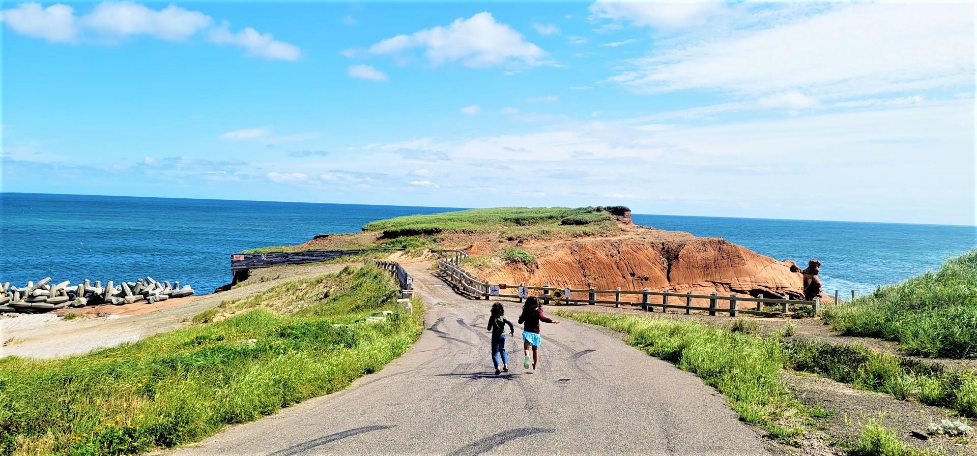 kids running on Magdalen Islands