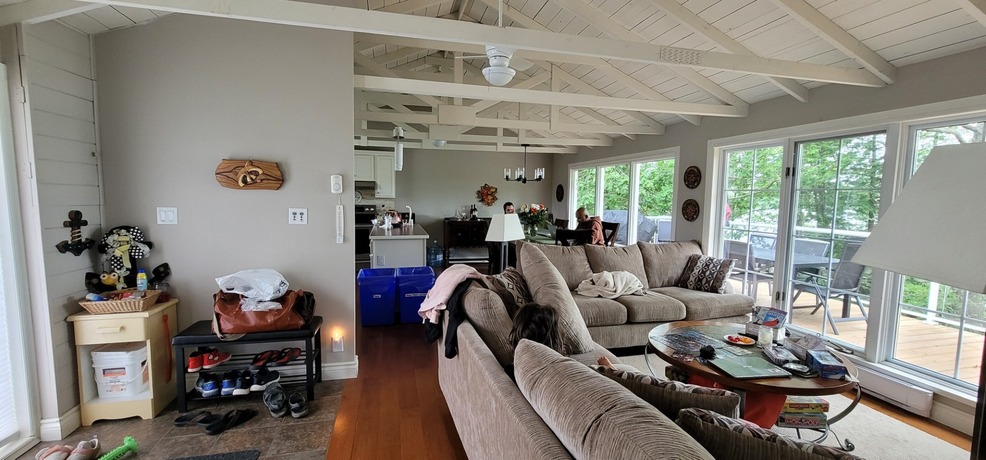living room with couch and high ceilings