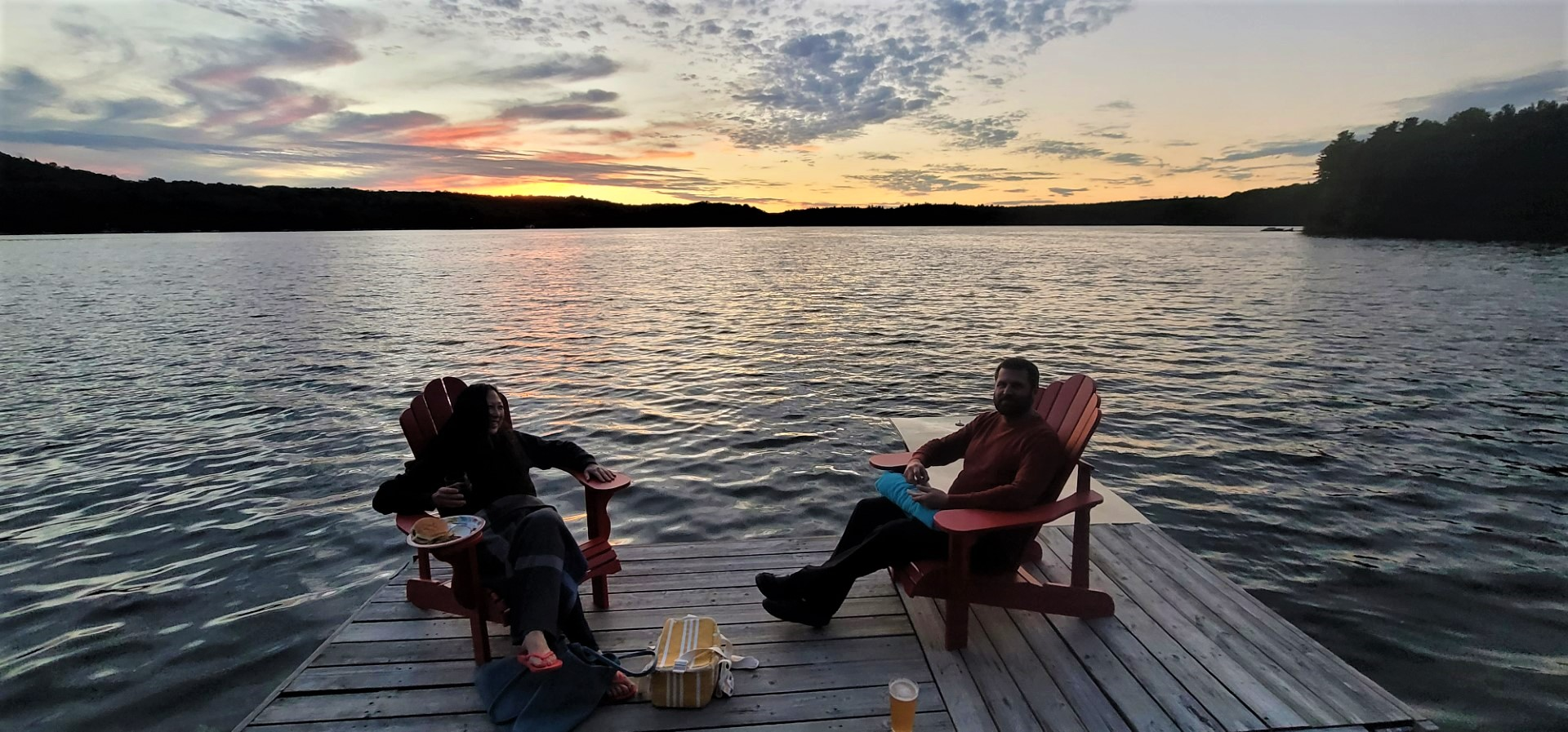 sunset with people enjoying drinks on a dock