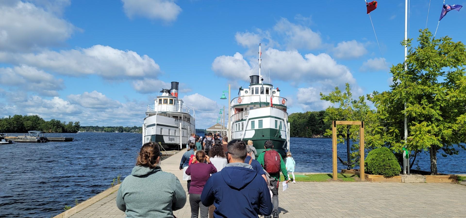 people in line to board the muskoka steamships