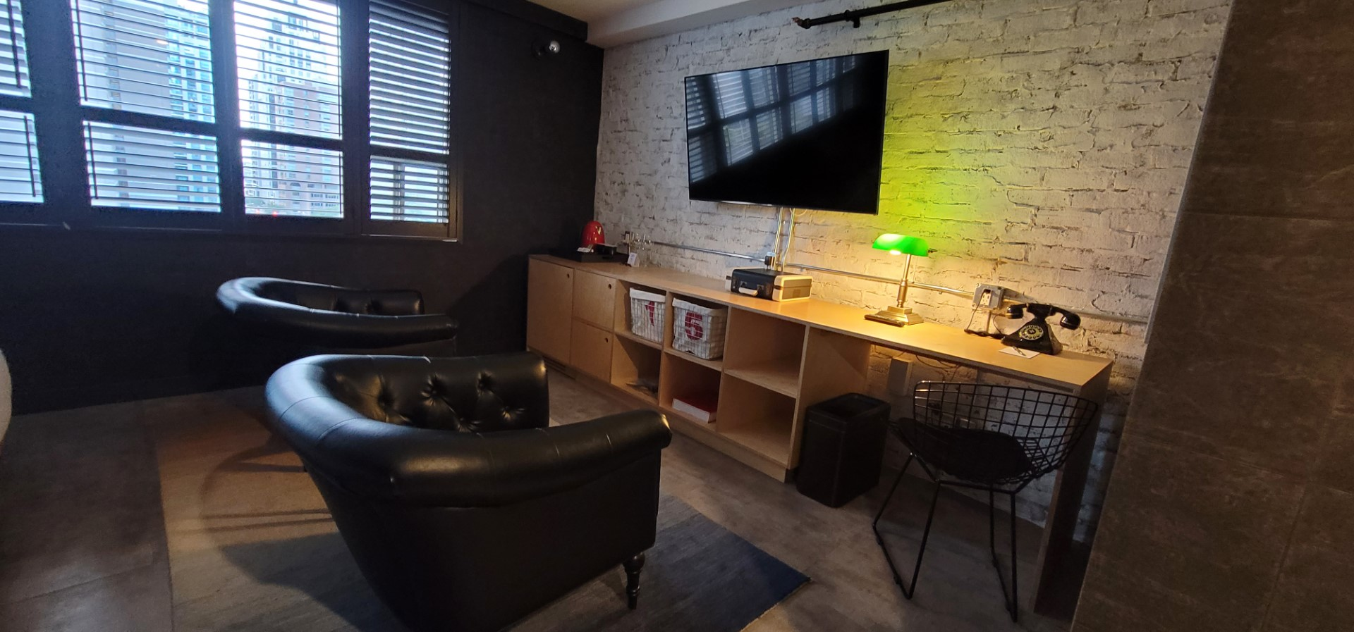 chairs and entertainment unit for a fun staycation Toronto