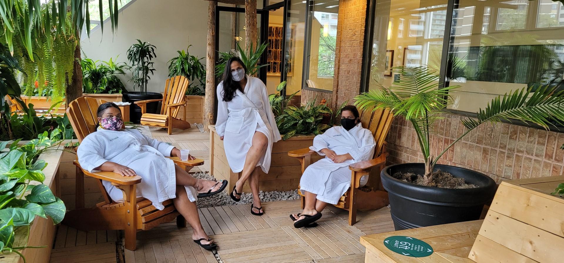 moms in spa robes wearing masks